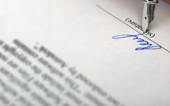 Contratto tra legale e Comune: il requisito della forma scritta è soddisfatto dalla procura e dalla sottoscrizione dell'atto difensivo